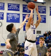 Lewis Clearwater puts up a shot for Horseheads during a 90-84 overtime win over Maine-Endwell in boys basketball Jan. 14, 2019 at Horseheads Middle School.