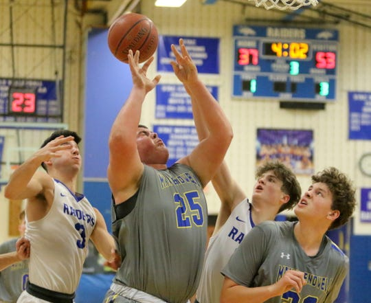 Maine-Endwell's AJ Desantis (25) battles for a loose ball with Mike Limoncelli (3) of Horseheads and Zach Malzeke of Horseheads on Jan. 14, 2019 at Horseheads Middle School.