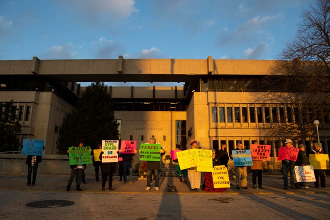 About 25 opponents of the Drag Queen Story Hour event to be held at the Evansville Public Library – North Park on February 23, 2019 voice their displeasure with signs outside the Civic Center before the Council meeting Monday evening.
