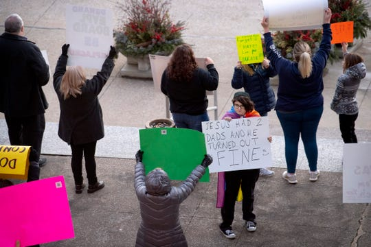 Audrey Johnson, 14, right center, displays her sign to protesters of the Drag Queen Story Hour outside the Civic Center before the Council meeting Monday evening. Johnson was supporting the group's right to read at the Evansville Public Library – North Park on February 23, 2019.