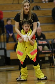 "Campbellsport High School Varsity Dance Team member Gabrielle Feucht uses a special harness, called an ""Upsee"" to support Lyssa Brath as they perform with the Shining Stars Dance Team during halftime at the North Fond du Lac High School vs. St. Mary's Springs Academy girls basketball game Jan. 4 at North Fond du Lac High School."