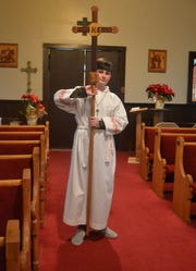 Historically, acolyte duties in the Episcopal Church were performed by men training for the priesthood. Today, children such as 14-year-old Tyler Rodrigue-Hejhal can serve as acolytes.