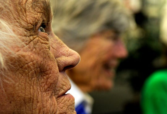 In this July 15, 2010, file photo, Millicent Peterson Young of Colorado Springs, Colo., a member of the Women Airforce Service Pilots, or WASPs, during World War II, looks on during an event at the Bird Aviation Museum and Invention Center in Sagle, Idaho. Young died Saturday, Jan. 12, 2019, at the age of 96. Young and other WASPs flew bombers and other warplanes in the United States during the war to free up male pilots for combat service overseas.