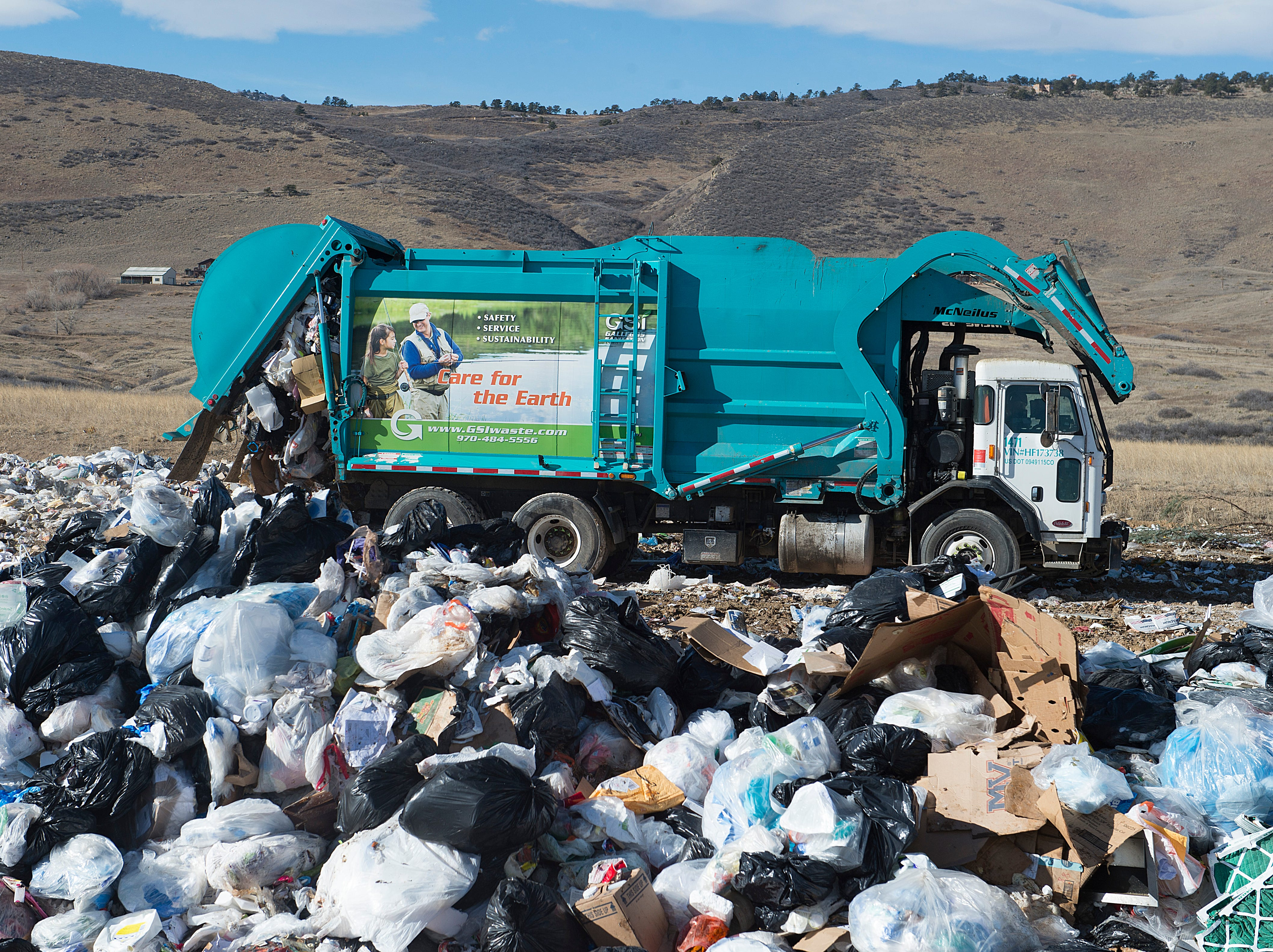 A commercial waste truck dumps a load at the Larimer County Landfill on Tuesday, January 15, 2019.