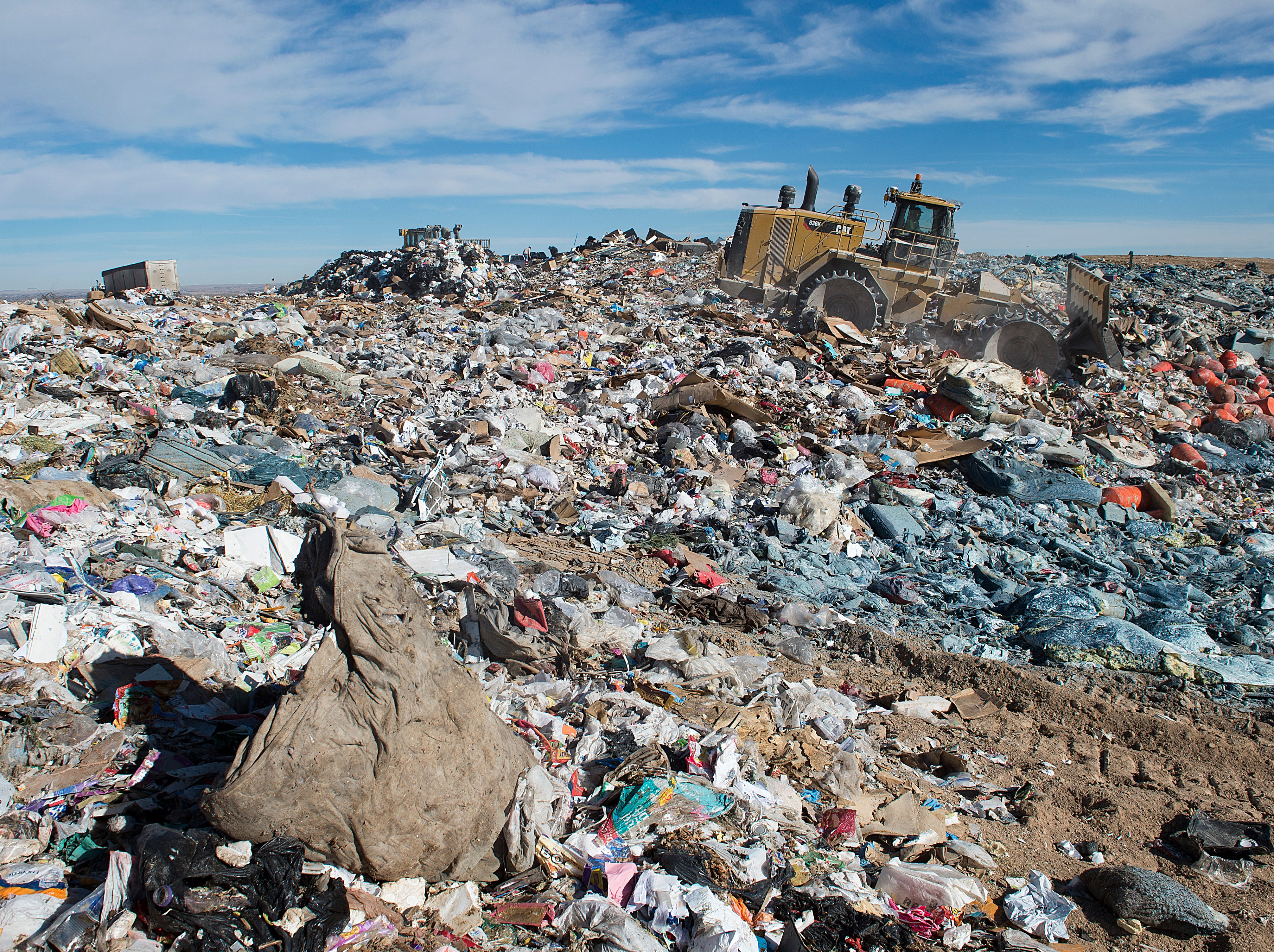 A bulldozer works to compact municipal waste at the Larimer County Landfill on Tuesday, January 15, 2019.