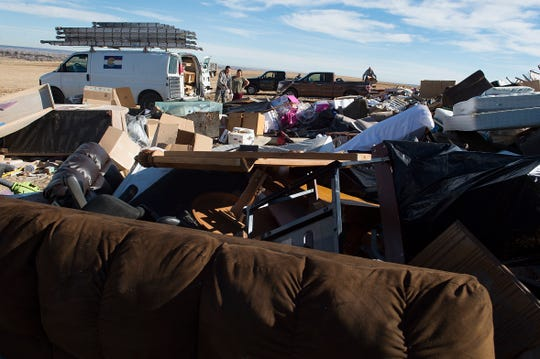 People pull up to a dump site to drop off materials at the Larimer County Landfill on Tuesday, January 15, 2019.