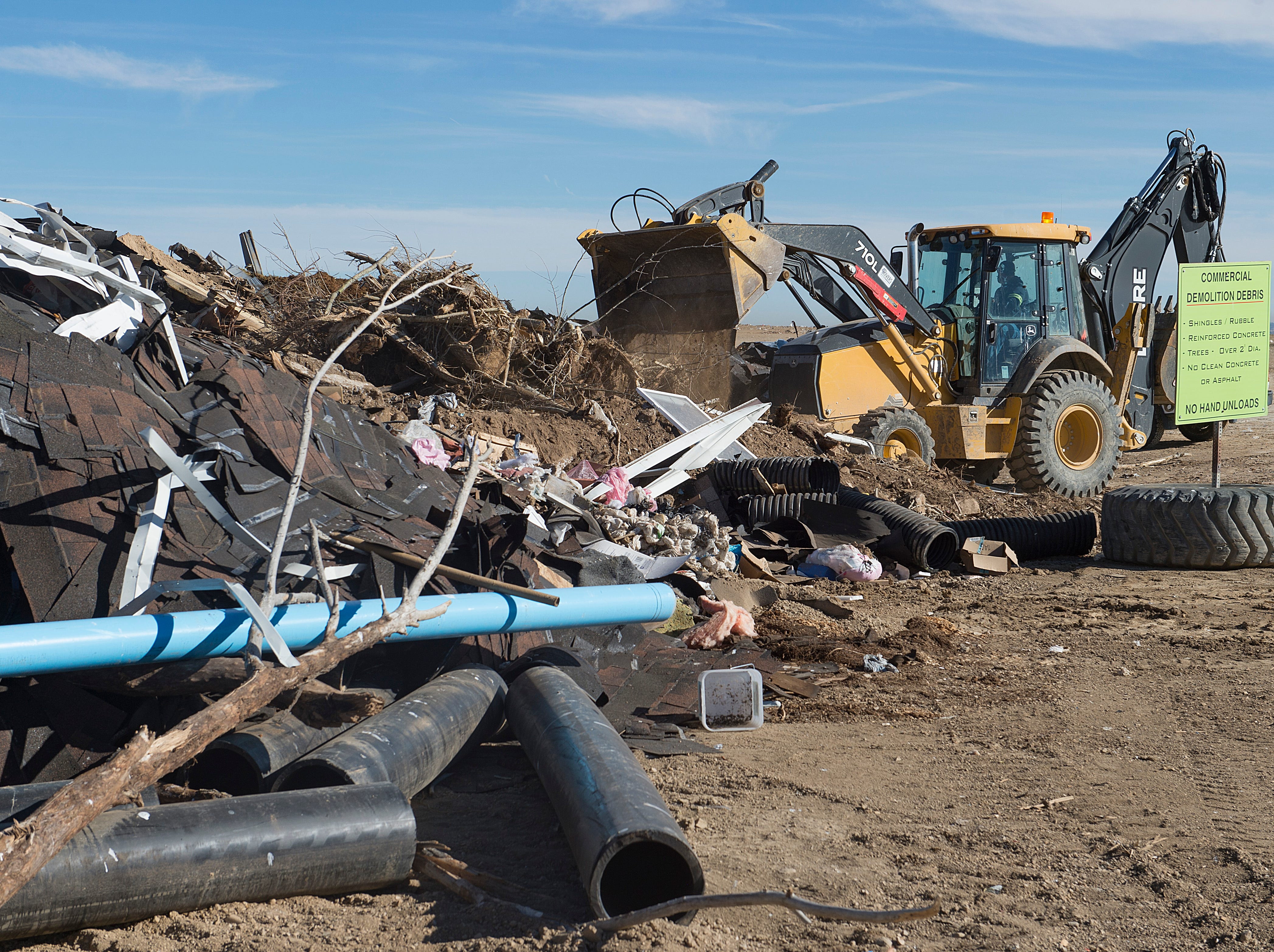 A truck works to tidy the dump site for construction and demolition waste at the Larimer County Landfill on Tuesday, January 15, 2019.