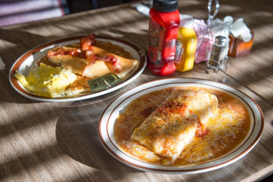A chorizo breakfast burrito is served smothered with cheese at Mountain Cafe on Tuesday, January 15, 2019. The breakfast and lunch spot is entering its 45th year in Old Town.