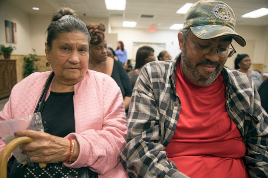 Sunrise Towers residents Louisa Riviera and her son Eddie Colon learn they will be getting relocation vouchers at a Monday meeting with the Housing Authority of the City of Fort Myers.  Because their landlord, Watersong Realty, canceled its HUD contract, they and 37 other families no longer have subsidized units. Colon worries they may end up sleeping in his car if they can't find alternative housing within the 90 day time limit.