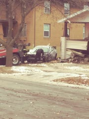 A man crashed a car into a Green Bay home after a short police chase.