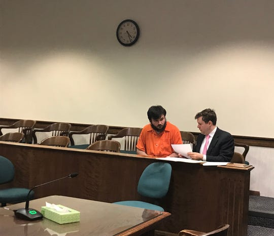 Shawn Gray meets with his attorney Daniel Adams prior to his plea hearing Tuesday.