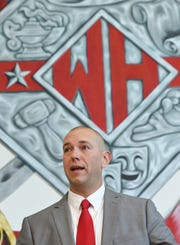 Travis Miller speaks at Wade Hampton High in Greenville during a press conference introducing him as their new head football coach Tuesday, January 15, 2019.