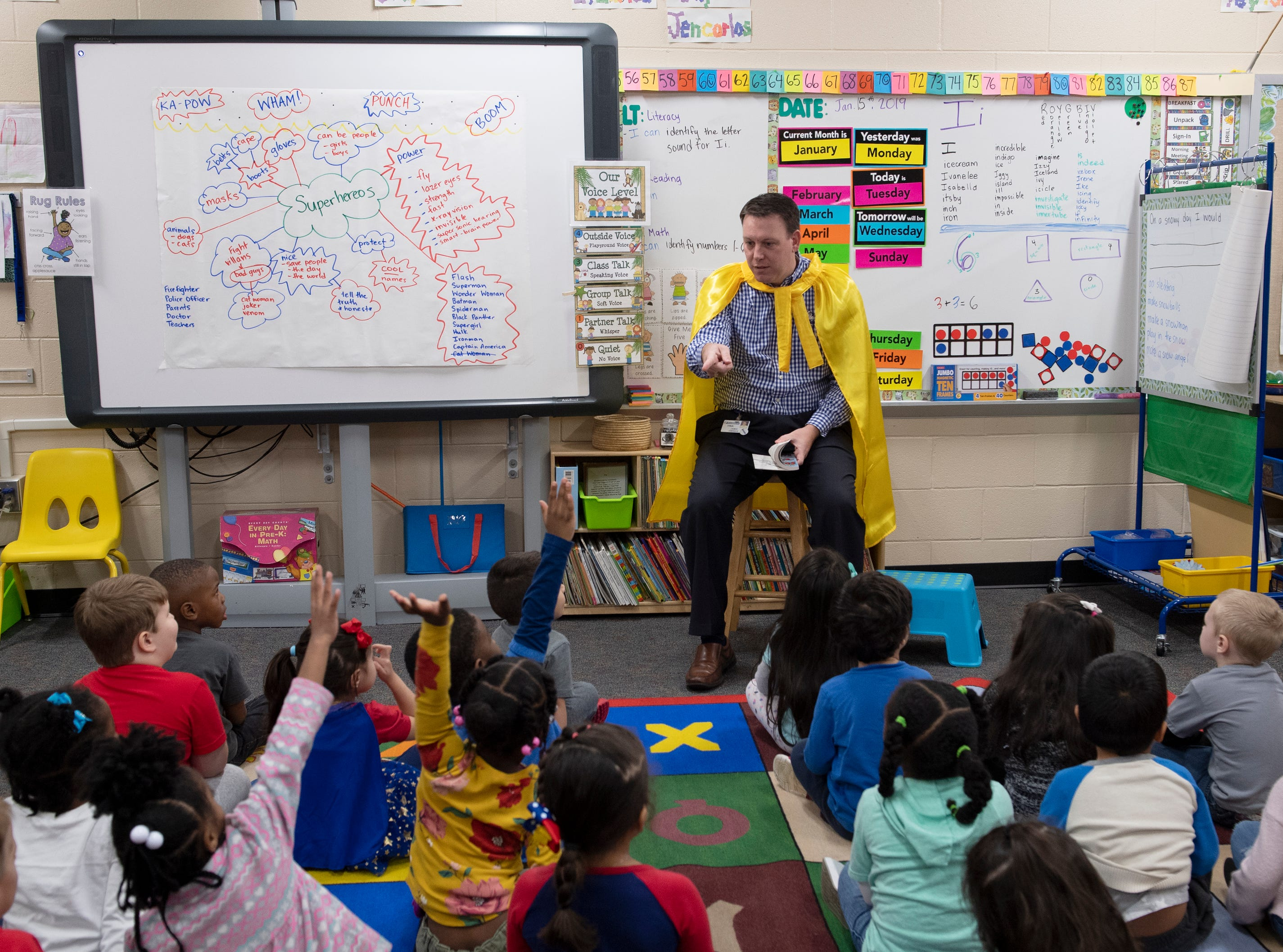 Jamie Owings, a senior compensation analyst at Michelin, reads an excerpt from The Curse of the Bologna Sandwich to students at East North Street Academy Tuesday, Jan. 15, 2019. Michelin donated copies of the book for students in the school. Owings has been volunteering with the school for 10 years.