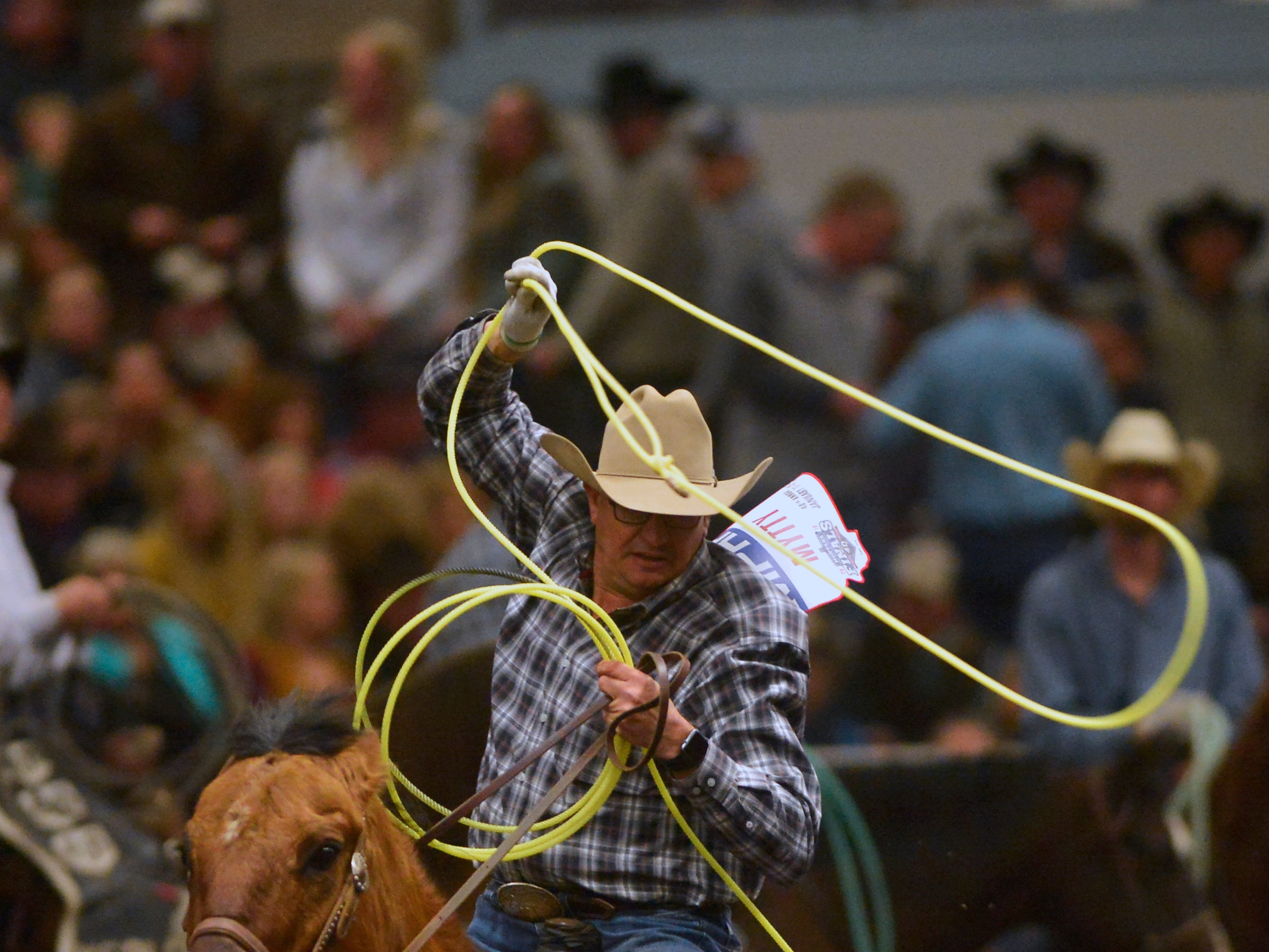Kory Mytty competes in the team roping event during the Montana Pro Rodeo Circuit Finals in the Pacific Steel and Recycling Four Seasons Arena, Friday, January 11, 2019.