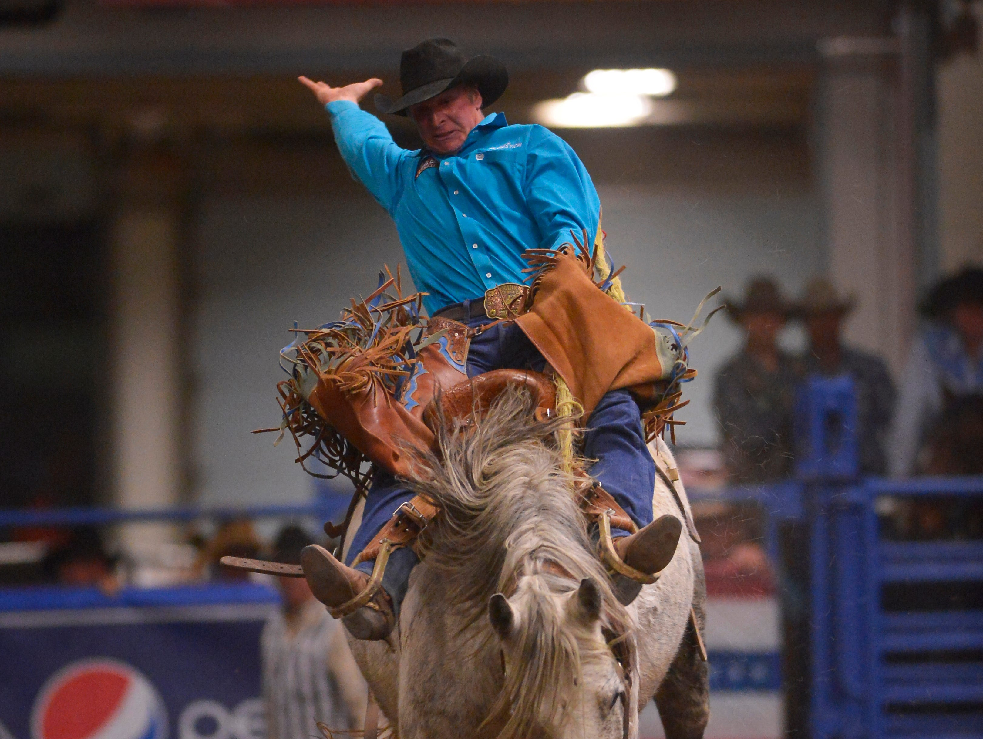 Josh Davison rides in the saddle bronc event at the Montana Pro Rodeo Circuit Finals in the Pacific Steel and Recycling Four Seasons Arena, Friday, January 11, 2019.