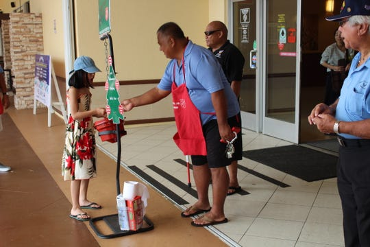 The Guam U.S. Air Force Veterans Association assisted the Salvation Army in ringing the bell for charity donations at the Agana Shopping Center, during the holidays. From left: Ed Dela Pena, Henry Manglona and Mr. Taianao. Not pictured: Joe Foster, Ray Salas, Al Perez, Joe Flores, Frank Mendiola, and Bill Cundiff.