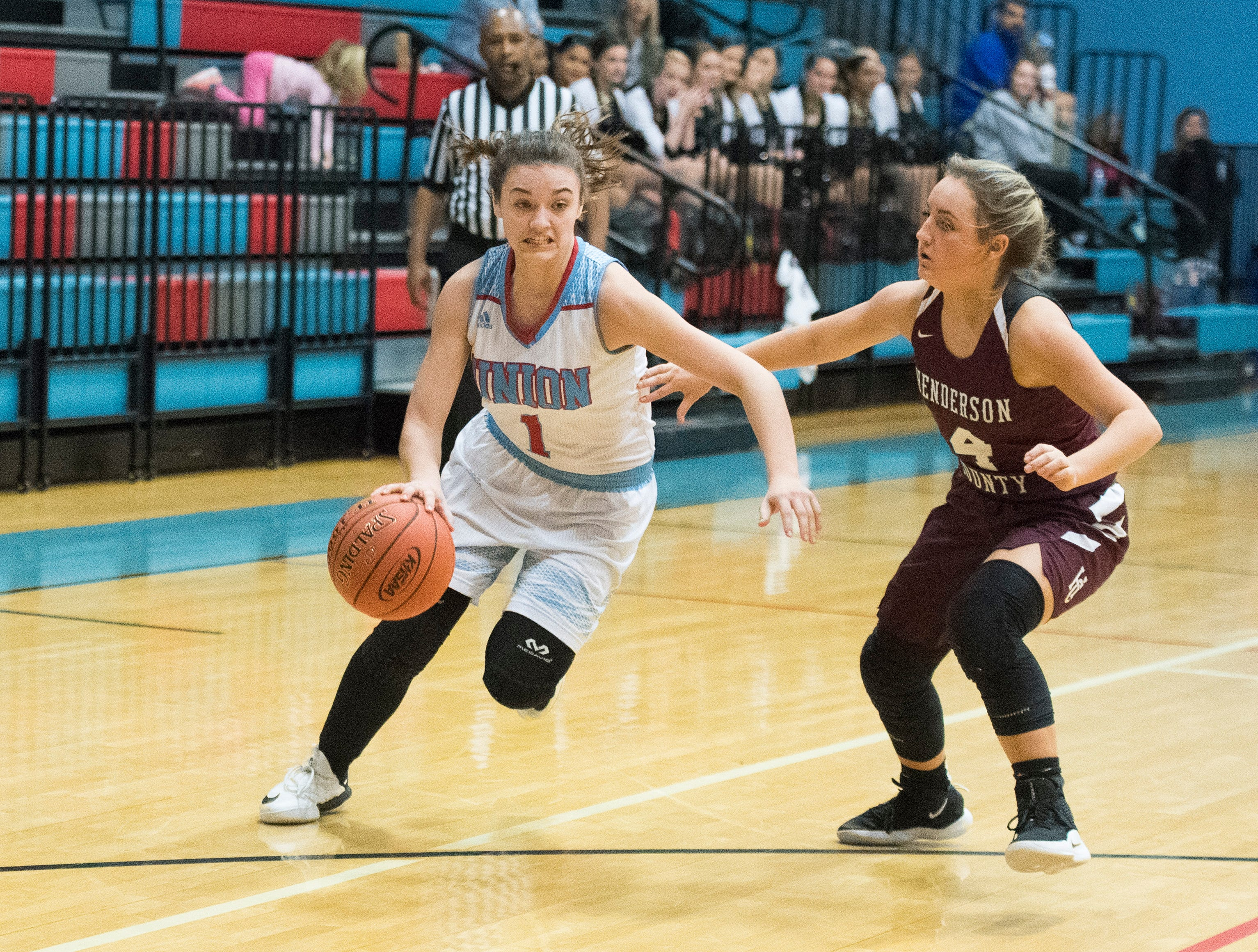 Union County's Emily Hibbs (1) drives the ball during the Henderson County vs Union County game at Union County High School Monday, Jan. 14, 2019.