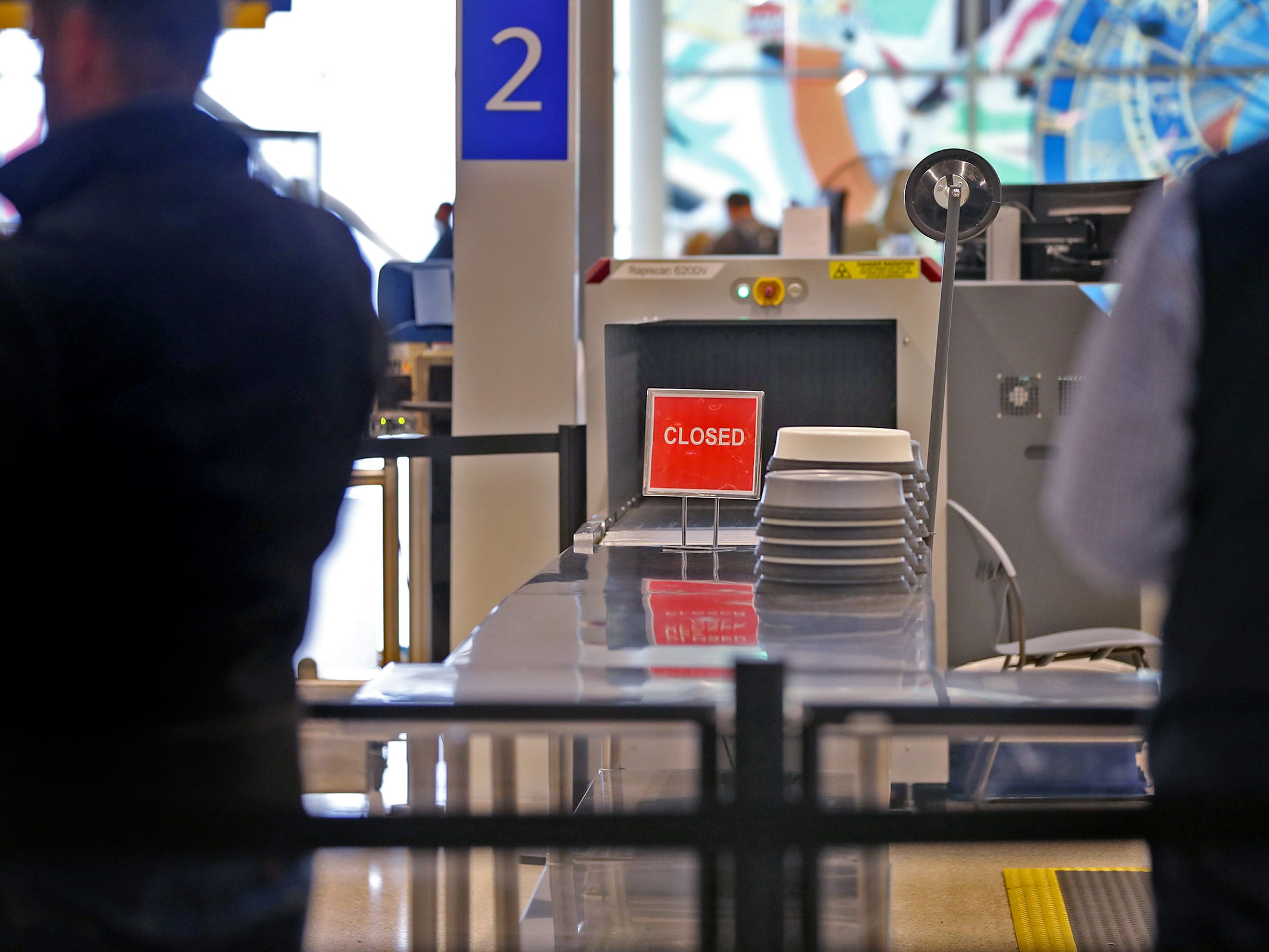 A closed line is seen at a security checkpoint at the Indianapolis International Airport, Tuesday, Jan. 15, 2019.