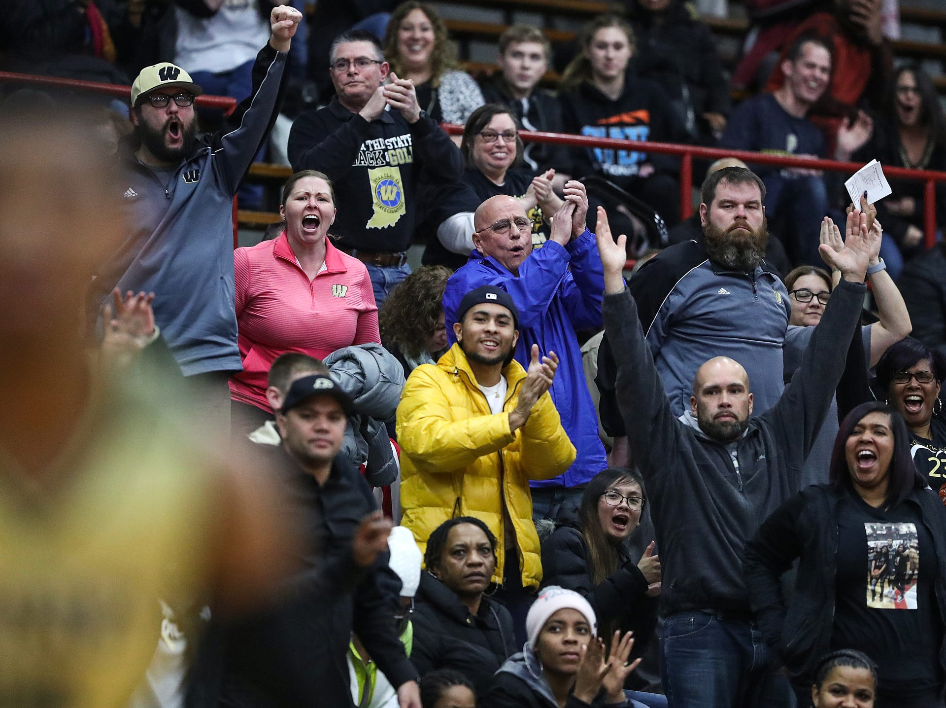 Warren Central fans cheer on the Warriors late in the second half of Marion County tournament finals at Southport High School in Indianapolis, Monday, Jan. 14, 2019. Warren Central won the title, 60-56.