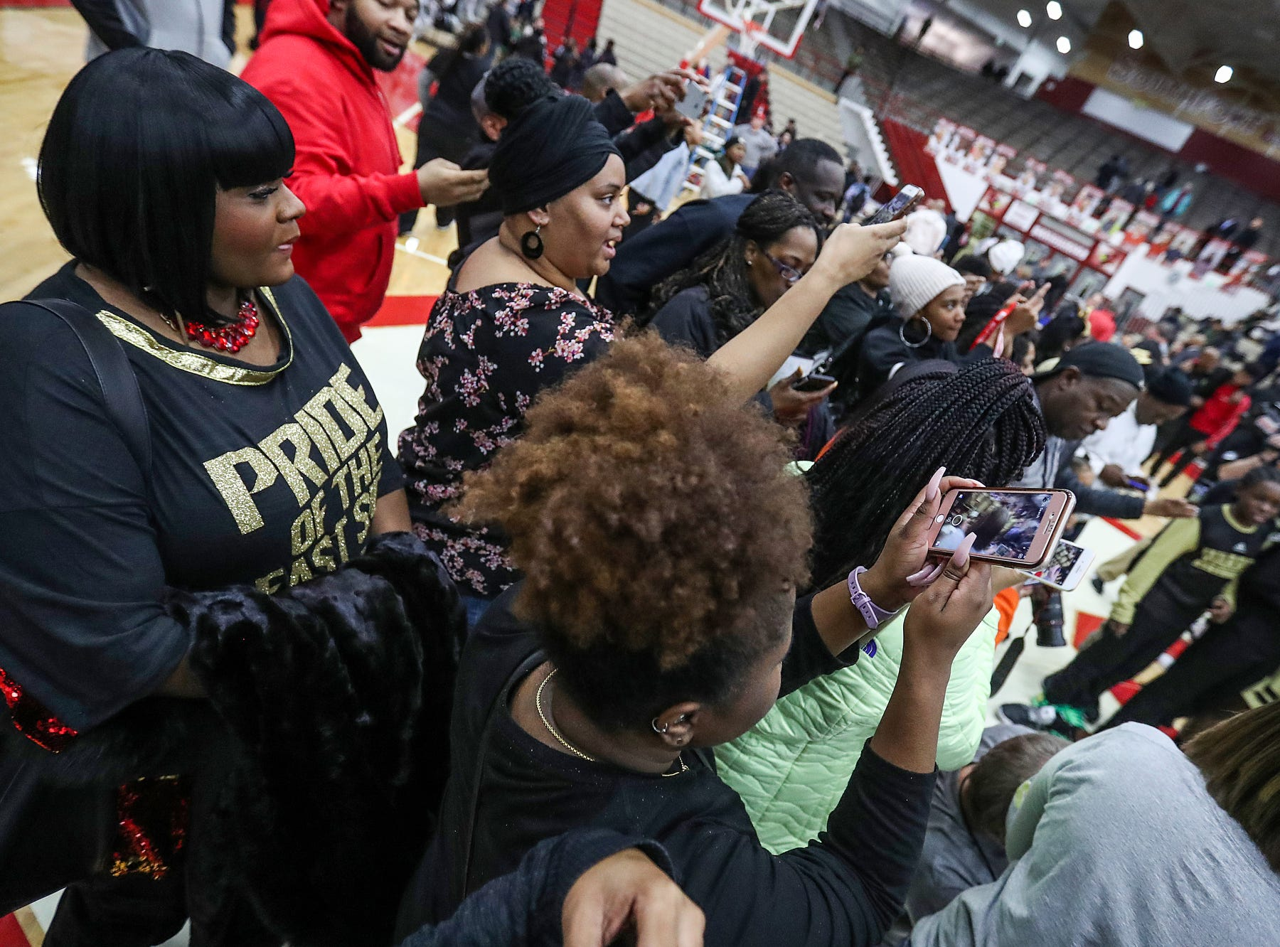 Parents take photos of the team after Warren Central won the Marion County tournament title at Southport High School in Indianapolis, Monday, Jan. 14, 2019. The victory marks a 46-game winning streak for the Warriors, the third-longest in state history.