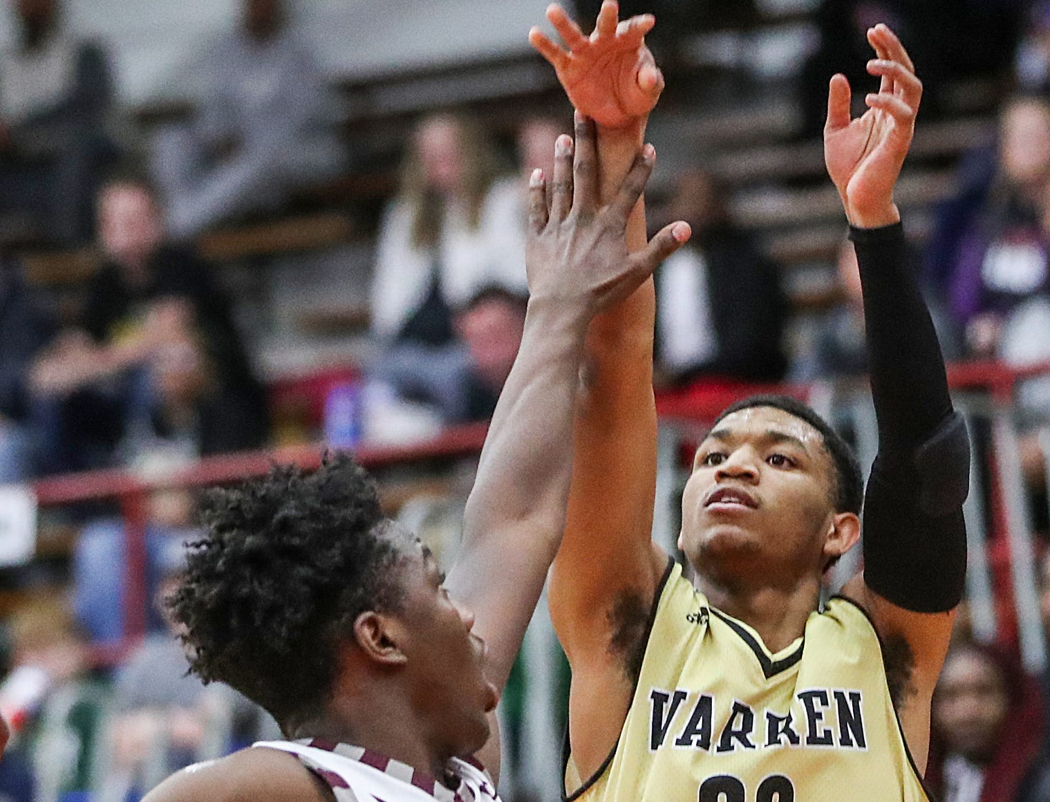 Lawrence Central Bears guard PJ Edwards (2) tries to stop a shot by Warren Central Warriors guard Isiah Moore (20) in the first half of Marion County tournament finals at Southport High School in Indianapolis, Monday, Jan. 14, 2019.