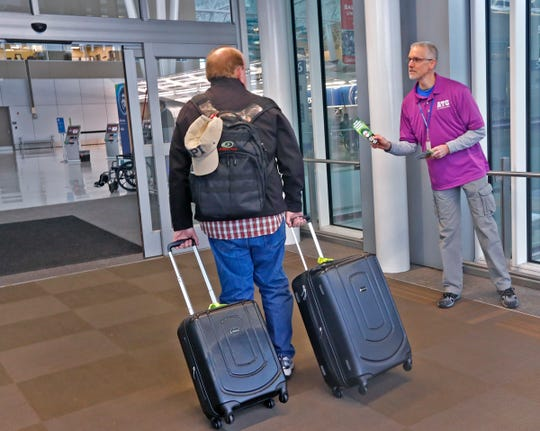 Air traffic control specialist Mark Wittmayer hands out information at the Indianapolis International Airport.