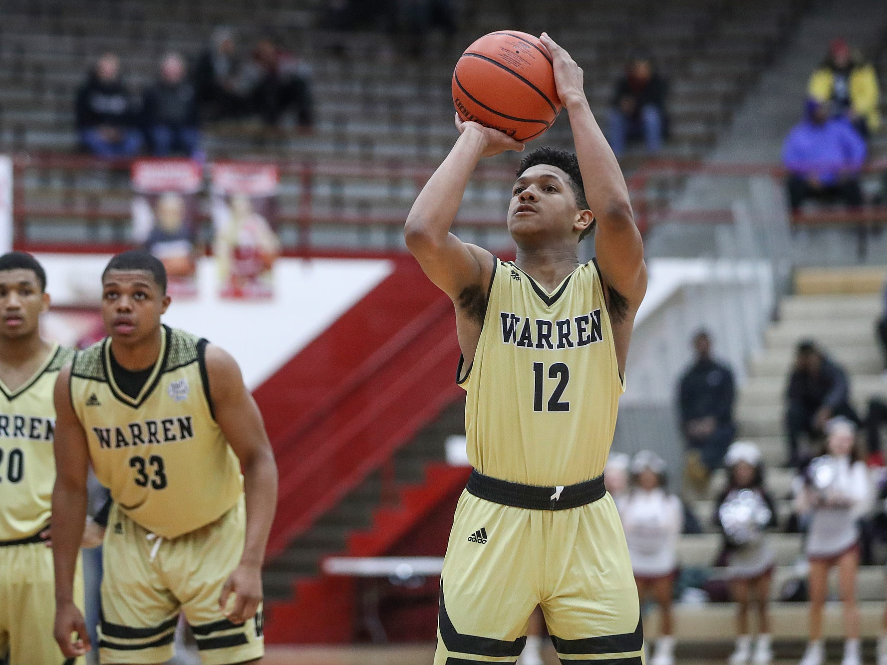 Warren Central Warriors Malik Stanley (12) scores two free throws at the foul line, to help clinch the Marion County tournament title over Lawrence Central, 60-56, at Southport High School in Indianapolis, Monday, Jan. 14, 2019. The victory marks a 46-game winning streak for the Warriors, the third-longest in state history.