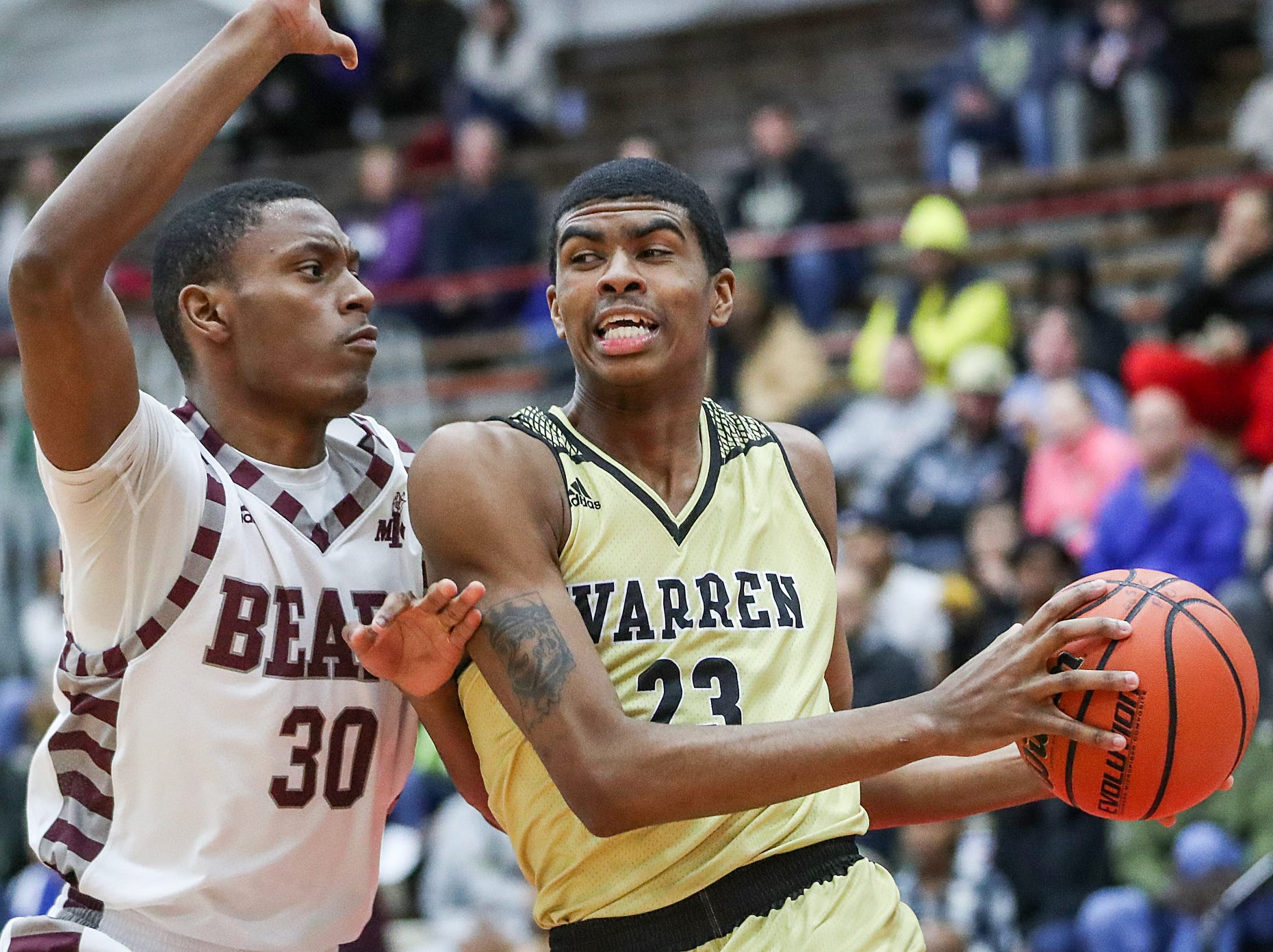 Lawrence Central Bears Wesley Jordan (30) guards Warren Central Warriors forward Jakobie Robinson (23) in the first half of Marion County tournament finals at Southport High School in Indianapolis, Monday, Jan. 14, 2019.