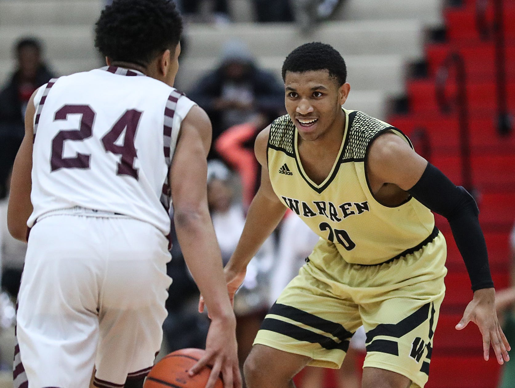 Warren Central Warriors guard Isiah Moore (20) guards Lawrence Central Bears Nijel Pack (24) in the second half of Marion County tournament finals at Southport High School in Indianapolis, Monday, Jan. 14, 2019. Warren Central won the title, 60-56.