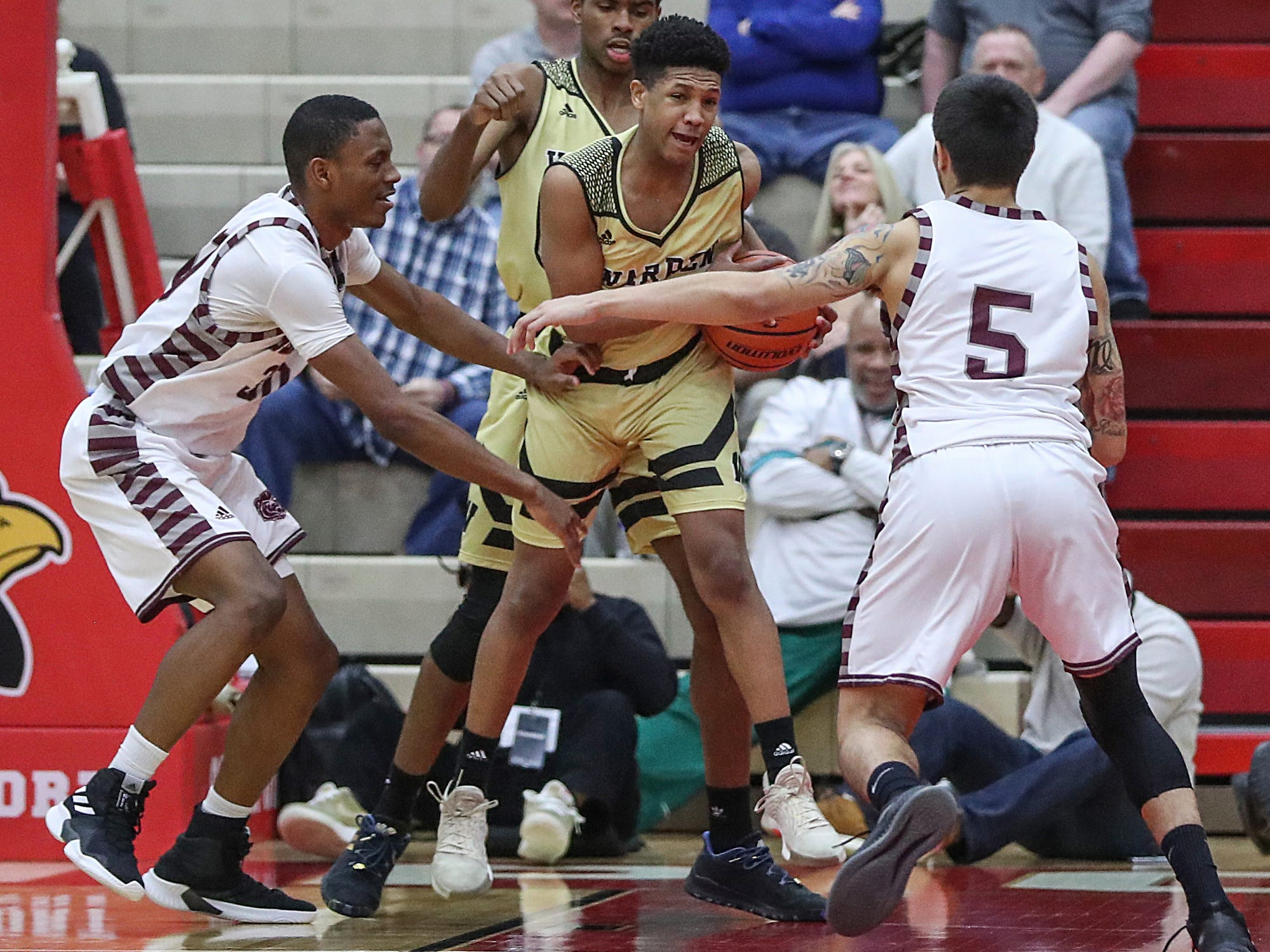 Warren Central Warriors Malik Stanley (12) is fouled late in the fourth quarter of Marion County tournament finals at Southport High School in Indianapolis, Monday, Jan. 14, 2019. The Warriors won 60-56. The victory marks a 46-game winning streak for the Warriors, the third-longest in state history.