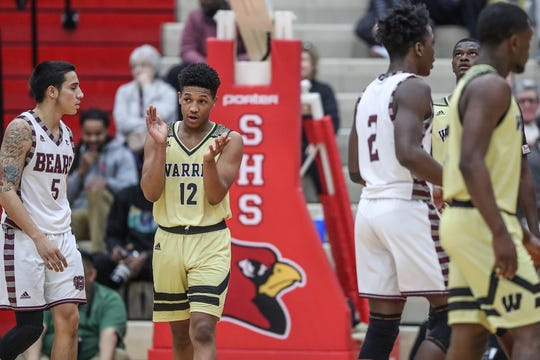 Warren Central's Malik Stanley (12) celebrates as the Warriors close in on a win over Lawrence Central, late in the fourth quarter of Marion County tournament title at Southport High School in Indianapolis, Monday, Jan. 14, 2019. The victory marks a 46-game winning streak for the Warriors, the third-longest in state history.