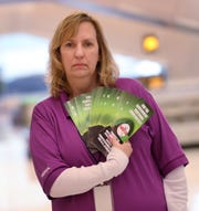 Air traffic control specialist Wendy Schneider shows pamphlets being handed out at the Indianapolis International Airport.