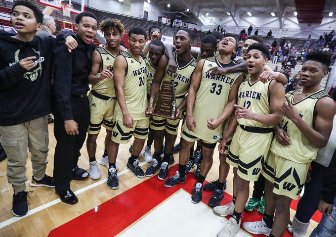 The Warren Central Warriors celebrate after winning the Marion County tournament title over Lawrence Central, 60-56, at Southport High School in Indianapolis, Monday, Jan. 14, 2019. The victory marks a 46-game winning streak for the Warriors, the third-longest in state history.