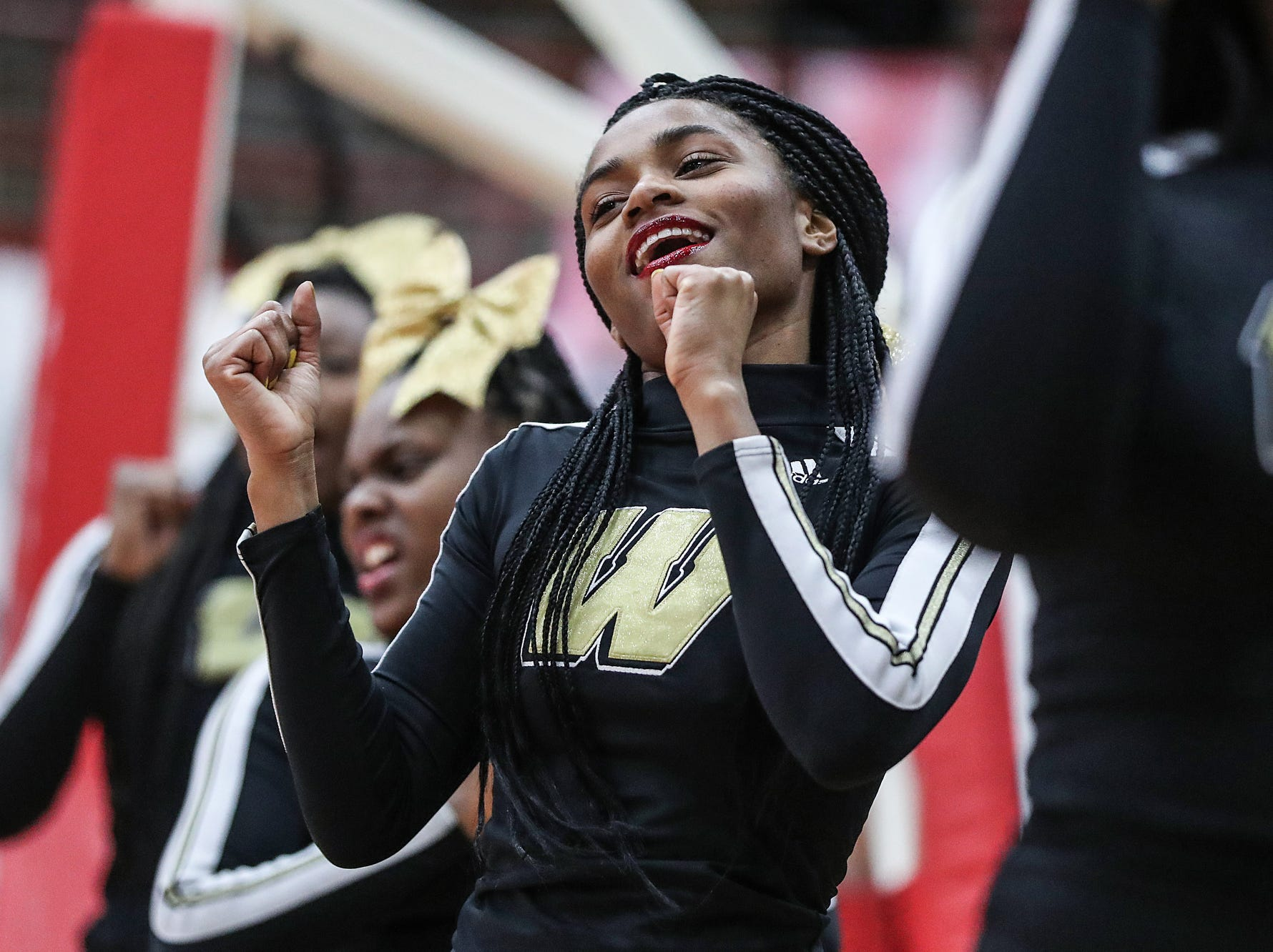 Warren Central cheerleaders root for the Warriors in the second half of Marion County tournament finals at Southport High School in Indianapolis, Monday, Jan. 14, 2019. Warren Central won the title, 60-56.