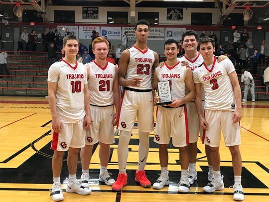 Left to right: Center Grove seniors Spencer Piercefield, Cameron Petty, Trayce Jackson-Davis, Ben Nicoson, Lucas Doyle and Ben Greller pose after winning Johnson County title Monday night at Edinburgh.