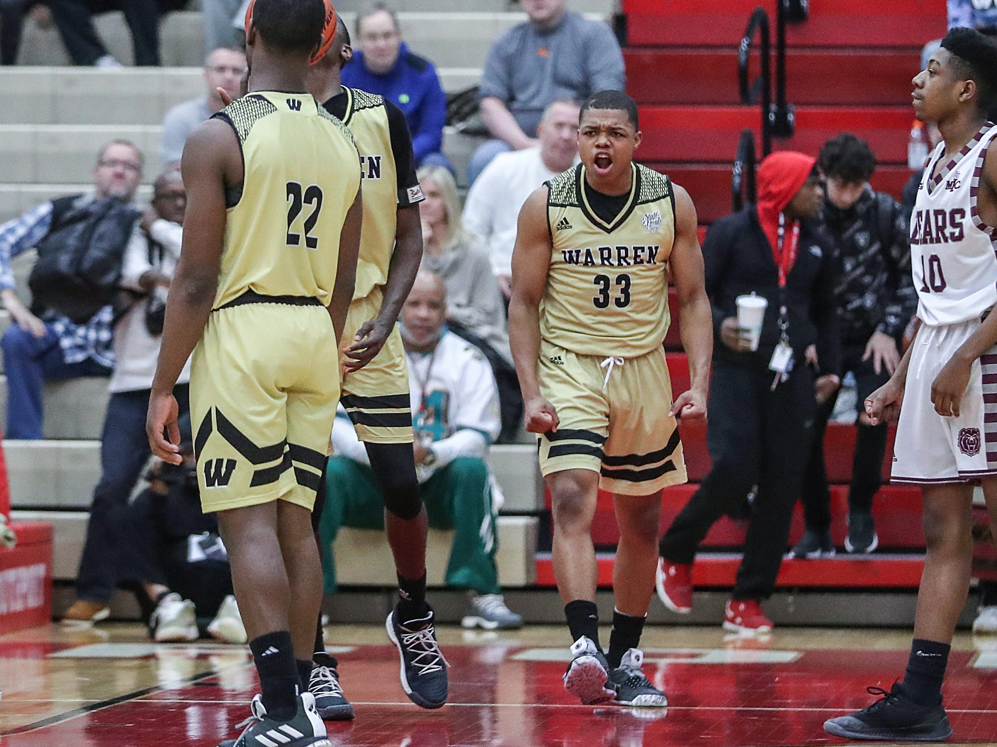 Warren Central Warriors Manuel Brown (33) celebrates as the Warriors clinch the Marion County tournament title over Lawrence Central, 60-56, at Southport High School in Indianapolis, Monday, Jan. 14, 2019. The victory marks a 46-game winning streak for the Warriors, the third-longest in state history.
