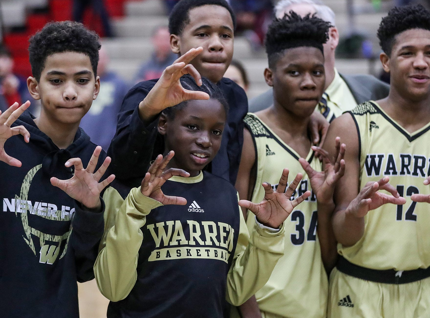 The Warren Central Warriors celebrate after winning the Marion County tournament title at Southport High School in Indianapolis, Monday, Jan. 14, 2019. The victory marks a 46-game winning streak for the Warriors, the third-longest in state history.