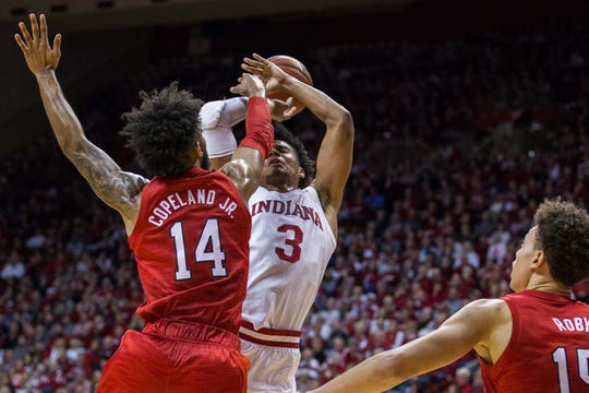 Cornhuskers forward Isaac Copeland Jr. (14) fouls Indiana Hoosiers forward Justin Smith (3) in the first half at Assembly Hall.