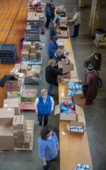 Workers helping at a food pantry.