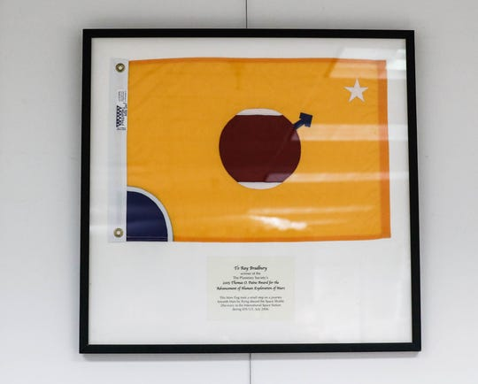 A flag that flew aboard the space shuttle Discovery was awarded to Ray Bradbury, winner of The Planetary Society's 2005 Thomas O. Paine Award for the Advancement of Human Exploration of Mars. It hangs inside The Center for Ray Bradbury Studies.