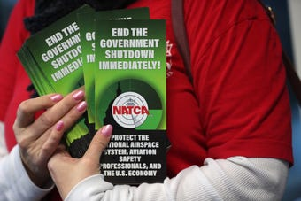 Air Traffic Controllers handed out pamphlets asking for the end of the government shutdown, and listing ways the shutdown affects aviation safety.