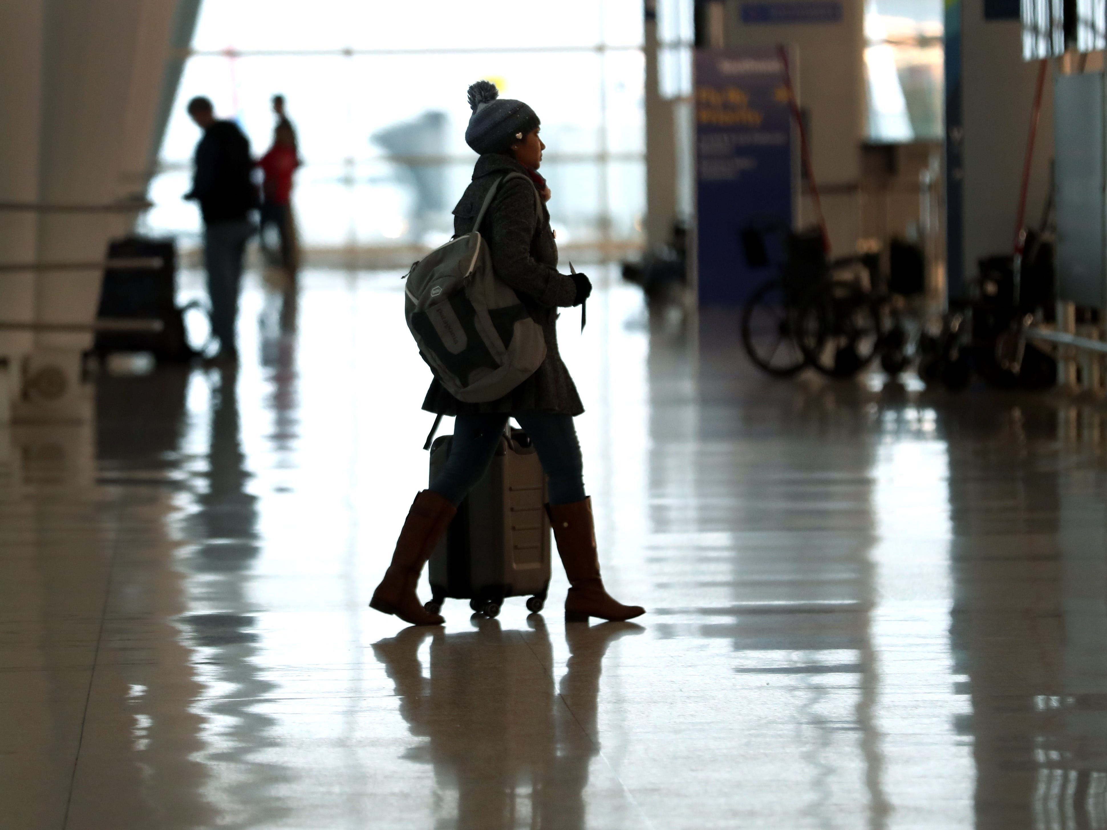 Travelers arrive at the Indianapolis International Airport, Tuesday, Jan. 15, 2019.