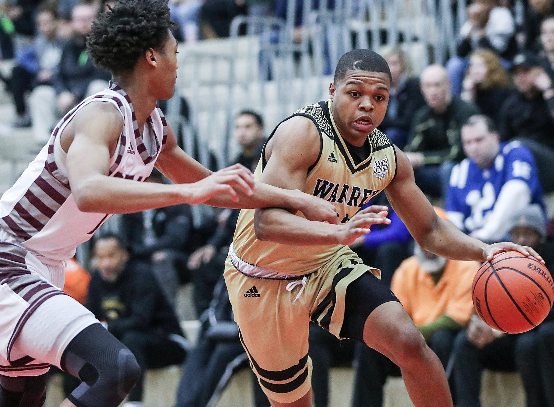 Lawrence Central Bears Dre Davis (14) guards Warren Central Warriors Manuel Brown Jr. (33) in the first half of Marion County tournament finals at Southport High School in Indianapolis, Monday, Jan. 14, 2019.