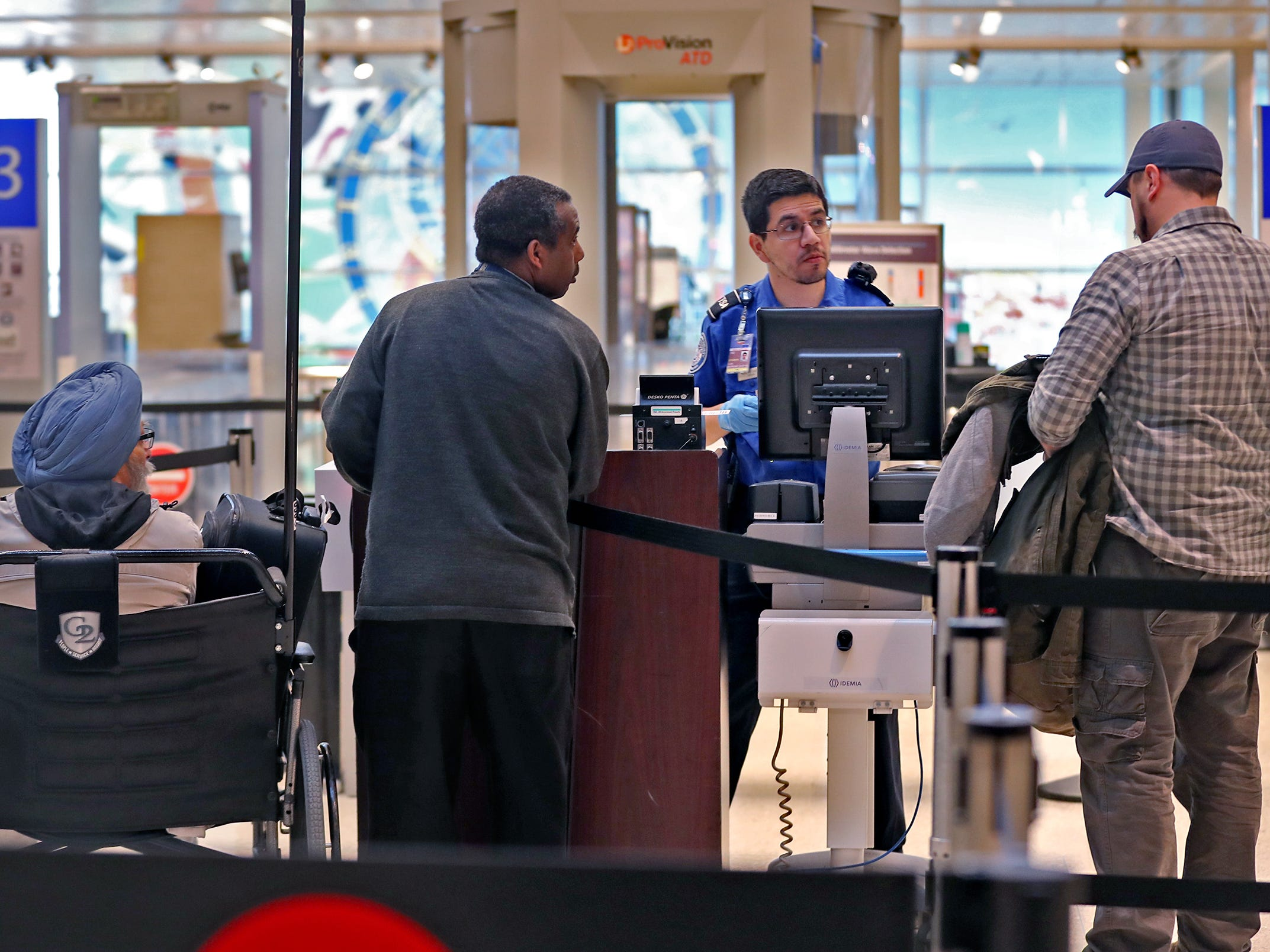 Travelers go through security at the Indianapolis International Airport, Tuesday, Jan. 15, 2019.