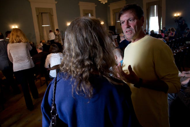 University of Iowa Iowa Writers' Workshop graduate John Falsey chats with his then-advisor Connie Brothers at the UI College of Liberal Arts and Sciences Alumni Fellows celebration at the Old Capitol on Thursday, Sept. 19, 2013.
