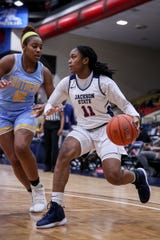 Jackson State's Summer Williams attempts to drive past Southern's Courtney Parsons during a game Monday at the Lee. E. Williams Athletic and Assembly Center in Jackson.