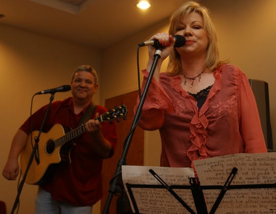 FILE: Chuck and Paula McGill performing at the Circles of Hope Telethon kickoff luncheon  July 29, 2004, at the Carl Perkins Center in Jackson.