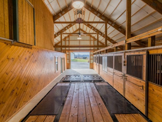 The 412-acre working cattle farm at Seven Lakes Ranch also has a heated and cooled barn.