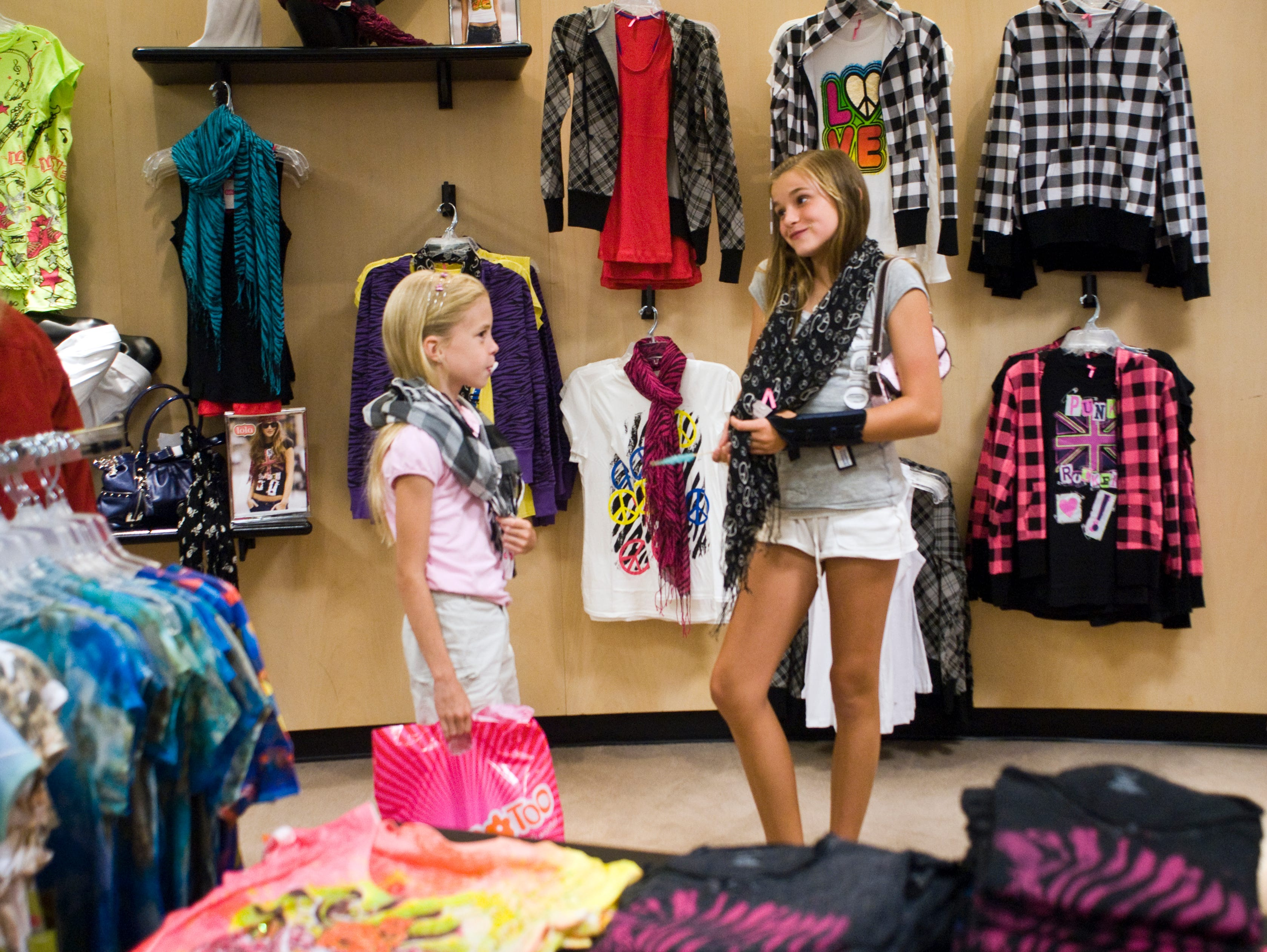 """OMG, look at these scarves,"" Lisa Loguillo, (cq), 9, left, of Oak Ridge, said to her friend, Katie Rhea, 11, right, as they shop in Dillards at the West Town Mall on Friday, August 7, 2009. ""The tax-free weekend is a little hard,"" Lisa's mother, Julie, said. ""because stuff is picked over and there isn't a lot of time to really shop. I think they should spread it over a couple of weeks."""