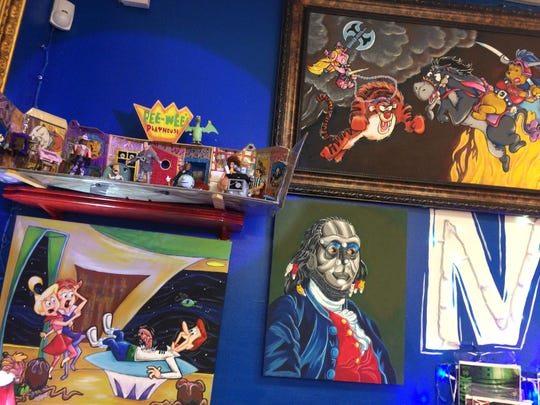 Original drawings on the walls of New Krypton Comics touch on a wide variety of subjects.